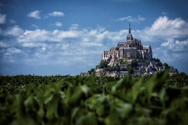 As if from an ancient legend, Mont St-Michel sits atop a rocky island in the ocean.