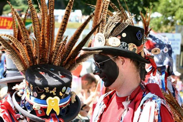 Morris dancers with black-painted faces. This is traditional in Morris dances along the border of Wales.