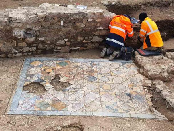 The mosaic tile floor found in the reception room of one of the domus townhouses recently unearthed in Nimes, France. (INRAP)