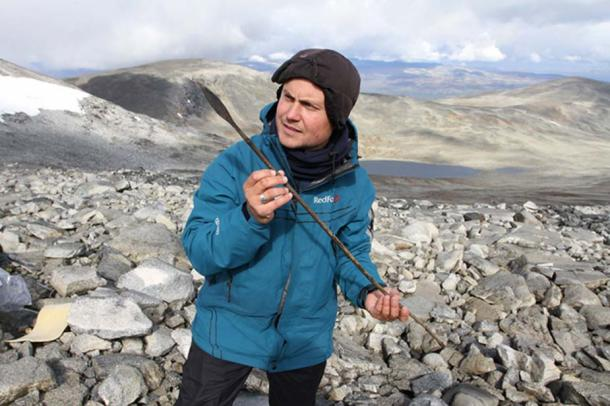 Mountains of Oppland, Norway. Archaeologist with an arrow aged around 1400 years.