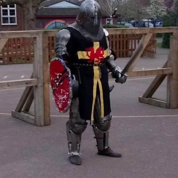 Mr Powell in his medieval gear and weapons. (Alun Powell/Facebook)