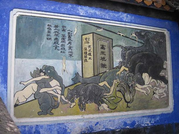 Mural in Fengdu Ghost City showing evil people falling to the underworld and being eaten by monsters.