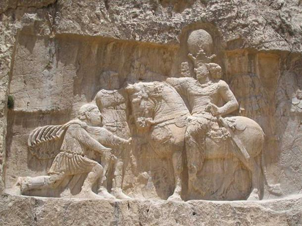 A rock-face relief at Naqsh-e Rostam, depicting the triumph of Shapur I over the Roman Emperor Valerian.
