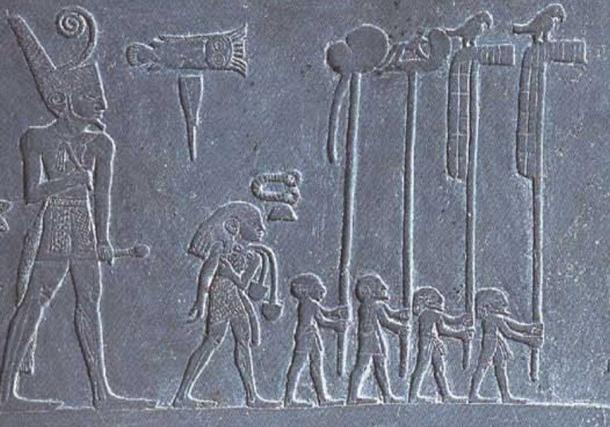 Narmer in a procession with standard bearers, falcons, on detail of the Narmer Palette.