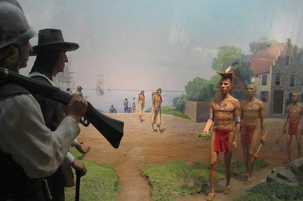 Diorama showing Native Americans meeting with European settlers.