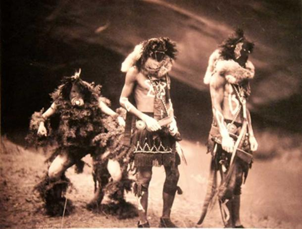 Navajo Yebichai (Yei Bi Chei) dancers. Edward S. Curtis. USA, 1900. Navajo healing ceremonies known as sings, or chants, are designed to restore equilibrium to the cosmos.  (Public Domain)