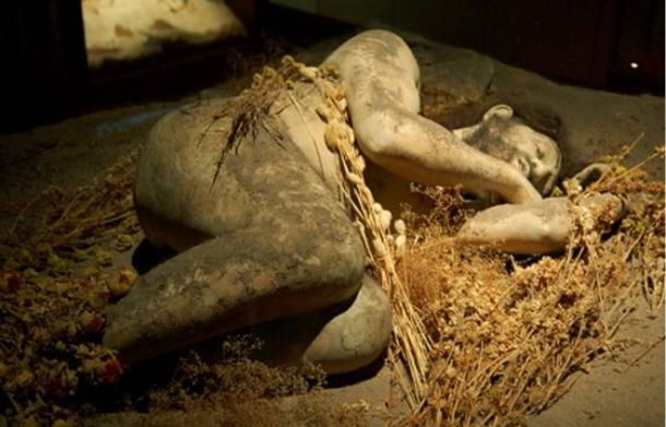 Museum reconstruction of a 50,000-year-old Neanderthal ritualistic burial.