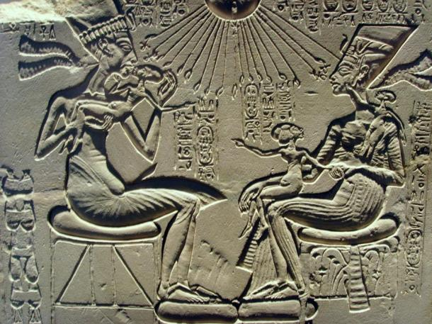 Akhenaten, Nefertiti and their children bask in the rays of the sun, Aten, a god that Akhenaten raised above all others.