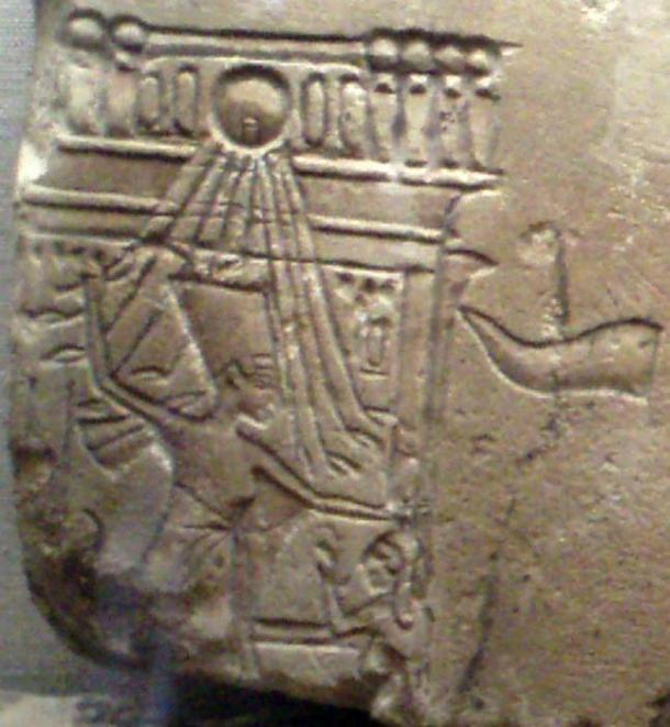 Nefertiti depicted in a familiar scene of a pharaoh smiting Egypt's enemy.