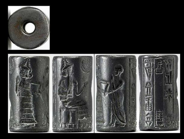 """A Neo-Sumerian (circa. 2150 -2000 BC) hematite cylinder seal depicting the presentation of a worshiper to a seated deity. An interceding goddess in a tiered dress leads the worshiper, who holds one hand before his face in a pious gesture. The three-line inscription records the seal owner's name and occupation: """"Lugal-dugedu, the scribe, son of Ur-dingira."""""""