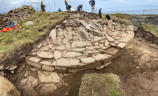 The Neolithic tomb site on the island of Sanday in the Orkneys where the two latest carved stone balls were found. And it is easy to understand that this cliffside site will one day soon fall into the sea. (University of Central Lancashire)
