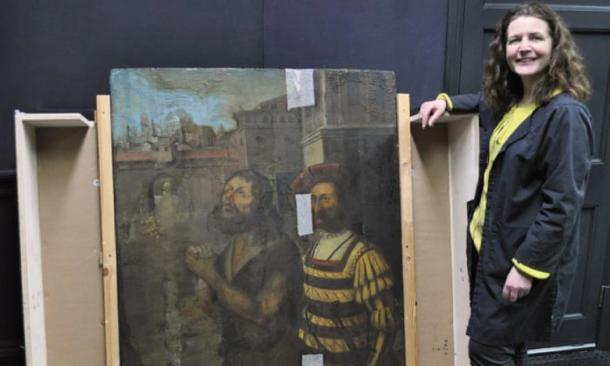 Nicky Grimaldi pictured with the panel painting from The Bowes Museum. (Northumbria University and Bowes Museum)