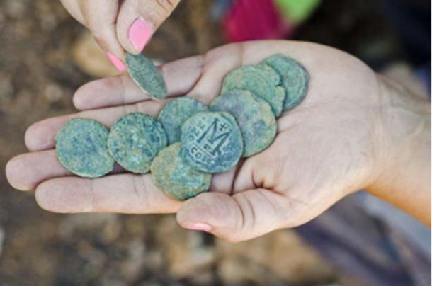 Nine bronze coins dating to the Byzantine period were hidden in the remains of a settlement near a highway to Jerusalem.