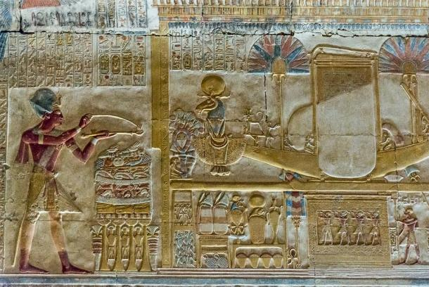 Note the Khnum figure with the solar disk on it's head at the front of the sacred boat. Chapel of Amun-Ra, Temple of Seti I, Abydos. (kairoinfo4u/CC BY NC SA 2.0)