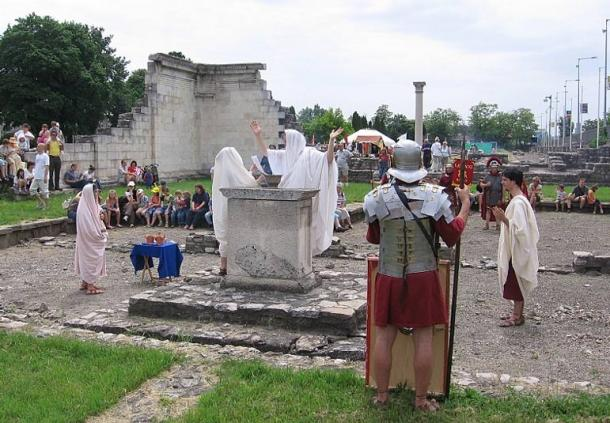 Members of Nova Roma conduct a Roman sacrifice to the goddess Concordia between the ruins of Aquincum, the modern city of Budapest, Hungary, during the Roman festival of Floralia, organized by the Aquincumi Múzeum.