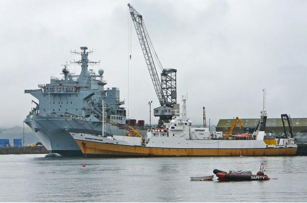 The Odyssey Explorer (midground) in Falmouth Docks, UK.  The salvage vessel belongs to Odyssey Marine Exploration, and is used in the exploration of underwater wreck sites.