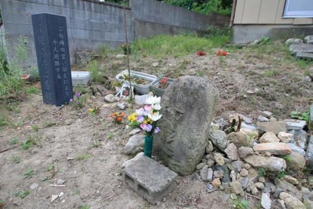 Old and new Jōgan tsunami warning stones.