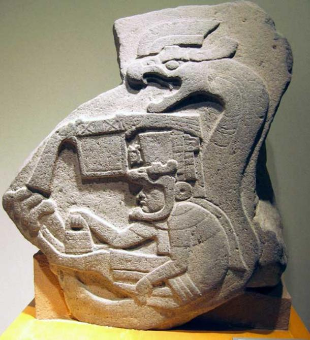 Olmec Monument 19, from La Venta, Tabasco, shows a man holding the handbag in his hand.