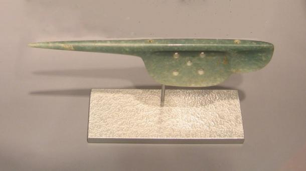 """Olmec-style jadeite """"spoon"""" believed to be a perforator used in bloodletting. 1500-300 BC."""