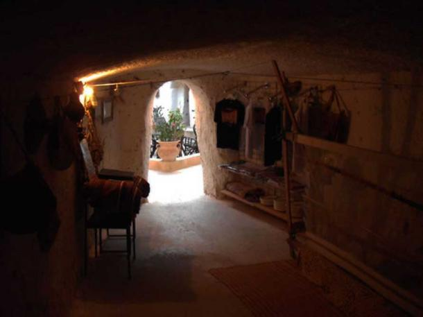 One house is accessed by descending down a tunneled passageway leading to a large circular pit.