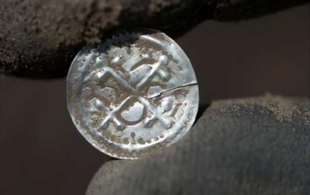 One of the coins found at the site. (YouTube Screenshot)