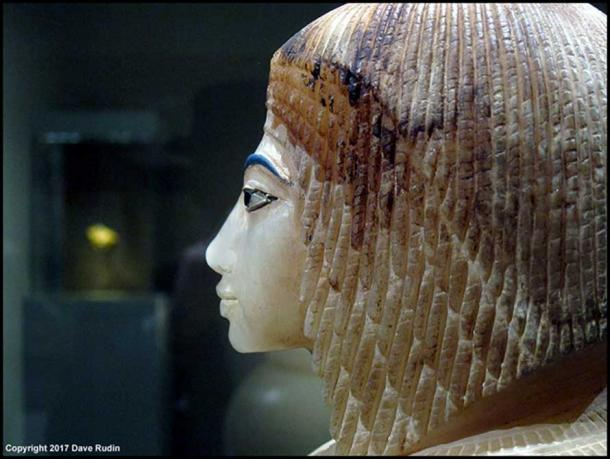 """One of the four elegant canopic jar stoppers made of Egyptian alabaster that was discovered in a niche in Tomb 55. It represents a royal lady wearing the Nubian wig. The uraeus was snapped off and the inscriptions on the jar erased in antiquity, but experts reconstructed the name """"Kiya"""". Davis/Ayrton excavations, 1907. Metropolitan Museum of Art, New York."""