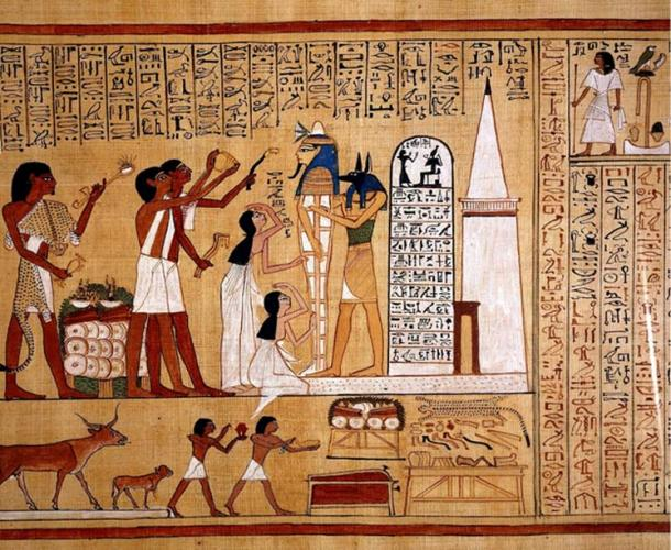 """One of the many splendid vignettes from the Book of the Dead of Hunefer, a scribe from the 19th Dynasty (reign of Seti I). While Anubis supports the mummy of Hunefer, the sem priest who wears the leopard-skin garb (extreme left), along with two other priests, performs the """"Opening of the Mouth"""" ritual. British Museum (public domain)."""