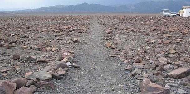 One set of geoglyphs were made by remove the reddish, iron oxide covered stones