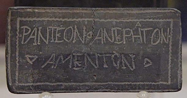 Opisthographic defixio tabella (curse tablet) with magic signs on one side and a Latin / Greek inscription of doubtful meaning on the other side. Origin unknown. (Public Domain)