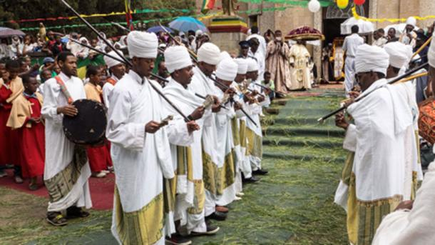 Orthodox priests dancing in front of Saint Mary church for 2015 Timkat in Addis Ababa, Ethiopia.
