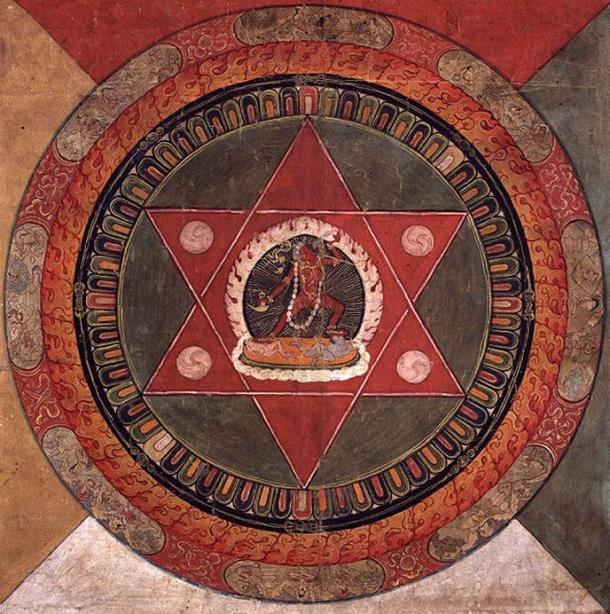 Painted 19th century Tibetan mandala of the Naropa tradition, Vajrayogini stands in the center of two crossed red triangles, Rubin Museum of Art.