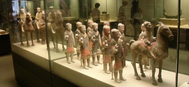 Painted ceramic statues of Chinese cavalrymen and infantrymen from the tomb of emperor Jing Di who ruled in the second century BC