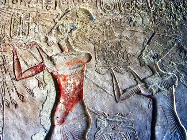 Painted wall relief shows Akhenaten and Neferiti worshipping the Aten. Tomb of Meryre II, Tell el-Amarna.