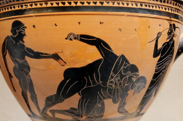 Pankratiasts fighting under the eyes of a trainer. Side A of an Attic black-figure skyphos, c. 500 BC.