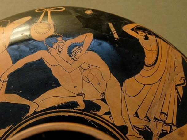 Pankration scene: The pankratiast on the right tries to gouge his opponent's eye; the umpire is about to strike him for this foul. Detail from an Ancient Greek Attic red-figure kylix, 490–480 BC, from Vulci. British Museum, London.