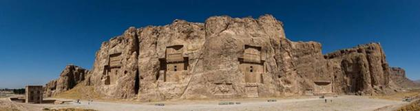 Panoramic view of the ancient Naqsh-e Rustam necropolis located in Fars Province, Iran. The site includes rock reliefs of Achaemenid and Sassanid periods, 4 tombs of Achaemenid kings and a Cube of Zoroaster (far left). (Diego Delso/CC BY SA)