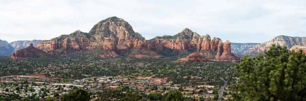 Panoramic overlook of Sedona Arizona with Capitol Butte and Coffeepot Rock in the background. (George Schmiesing / Adobe Stock)