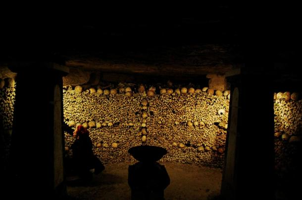 The living and the dead both inhabit the Paris Catacombs.