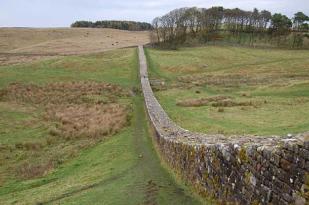 Part of Hadrian's Wall running downhill from the northeast corner of Housestead's Roman Fort.