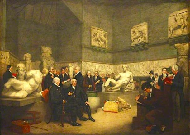 The Parthenon Marbles in a temporary Elgin Room at the British Museum surrounded by museum staff, a trustee, and visitors in 1819. (Understat / Public Domain)