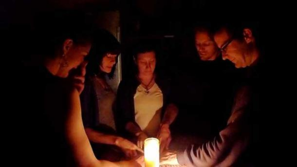 Participants in a Ouija game.
