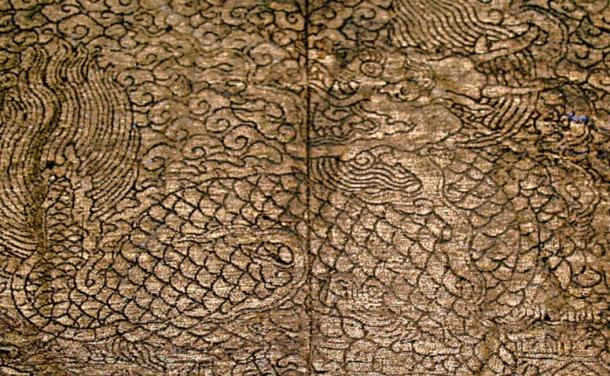 Patches from an undershirt in the wife's coffin. The patches depict a Kylin or Qilin, a mythical creature with a dragon's head, tail and a scaly body