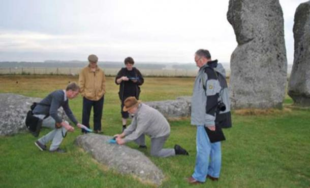Paul Devereux measuring sound frequencies emitted by the stones at Stonehenge