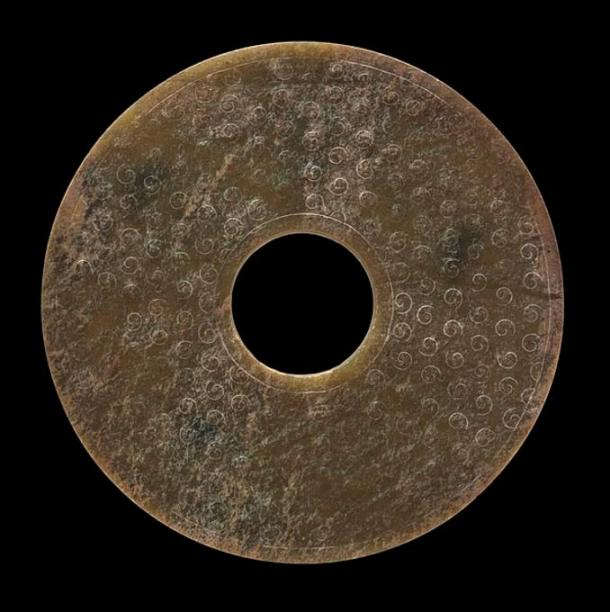 Perforated Chinese Disk (Bi) with unfinished Relief Spirals, circa 481-100 BC.