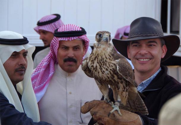 Professor Michael Petraglia, the research study's senior author, of the Max Planck Institute for the Science of Human History, taking a break with an iconic falcon in Saudi Arabia. (Conversations in Human Evolution)