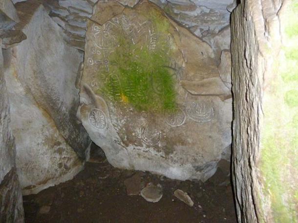 Petroglyphs inside cairn T