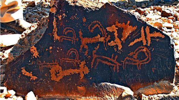 Petroglyphs of Ibexes and symbols, Mount Karkom, Negev, Israel.