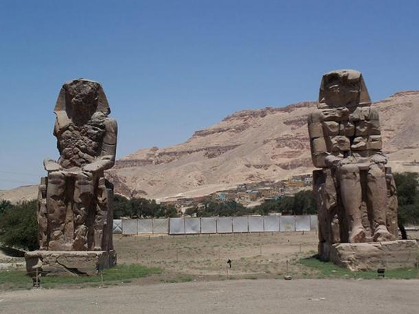 Pharaoh Amenhotep III's Sitting Colossi of Memnon statues at Luxor, Egypt.