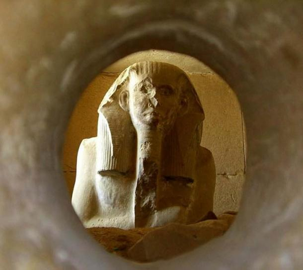 Pharaoh Djoser's Ka statue peers through the hole in his serdab, ready to receive the soul of the deceased and also offerings presented to it. 3rd Dynasty. Saqqara. (Photo: Neithsabes / public domain)
