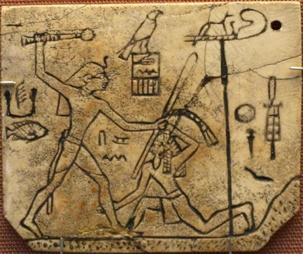 """Pharaoh Den from Dynasty 1 smiting a foreign enemy with his """"strong arm"""" and """"mighty hand"""", traditions which were very ancient and central to Egypt's concept of authority (~2950 BC). The """"MacGregor Label"""" made of ivory, found in Den's tomb at Abydos, now in the British Museum. (CaptMondo/CC BY 2.5)"""